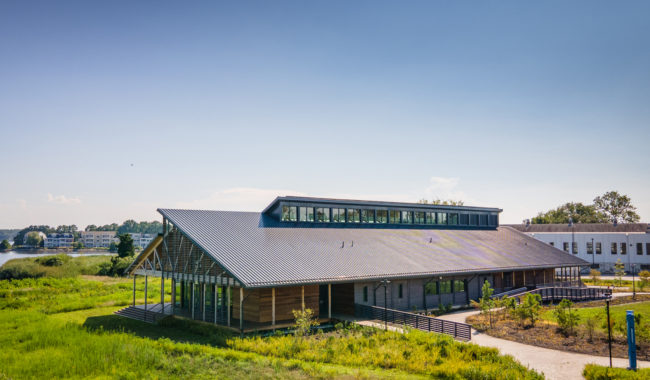 landscape view of semans griswold environmental hall sitting beneath blue sky