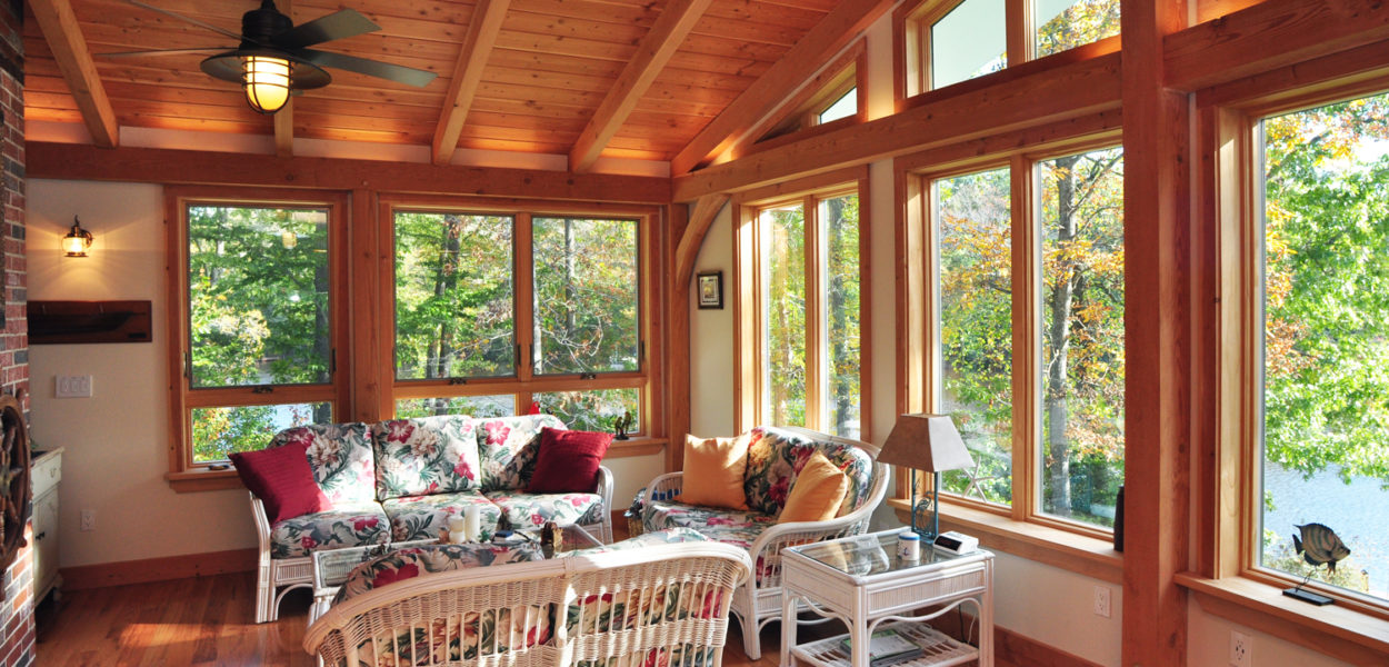 timber frame sunroom with large windows overlooking body of water in maryland