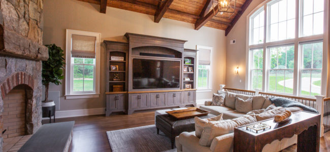 living room with large entertainment center and white section couch in menham nj