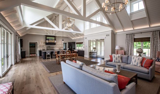 large open living space with couches and dining room furniture