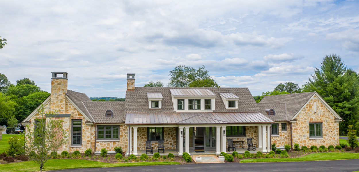 farm house style luxury home sitting beneath blue sky in towson maryland
