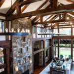 timber frame trusses featured in beautiful high ceiling living space in villanova pa home
