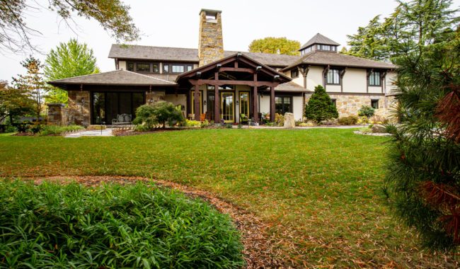 front lawn view of picturesque home that utilizes timber frame trusses in villanova pa