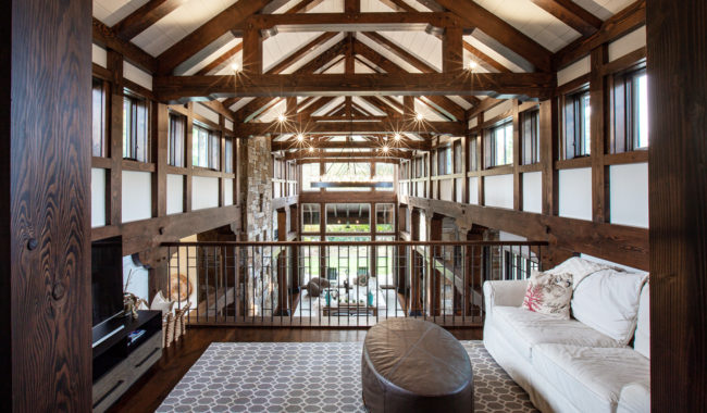timber frame trusses sitting on top of large living space with tables and chairs in villanova pa